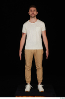 Trent brown trousers casual dressed standing white sneakers white t shirt whole body 0009.jpg